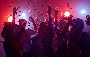 Young people dancing in night club